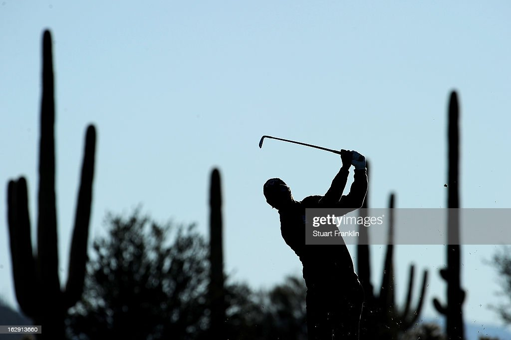Nicolas Colsaerts of Belgium watches his shot on the first hole during the third round of the World Golf Championships - Accenture Match Play at the Golf Club at Dove Mountain on February 23, 2013 in Marana, Arizona.