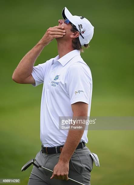 Nicolas Colsaertsof Belgium reacts to missing his putt for a 59 on the 18th hole during the first round of the Portugal Masters at Oceanico Victoria...