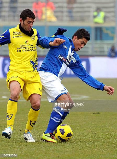 Nicolas Cordova of Brescia Calcio competes with Mariano Bogliacino of AC Chievo Verona during the Serie A match between Brescia Calcio and AC Chievo...