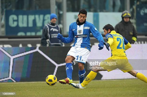 Nicolas Cordova of Brescia competes with Mariano Boghliacino of Chievo during the Serie A match between Brescia Calcio and AC Chievo Verona at Mario...