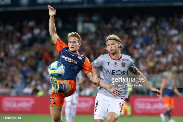 Nicolas Cozza of Montpellier Herault SC tries to control the ball against Kasper Dolberg Rasmussen of OGC Nice during the Ligue 1 match between...