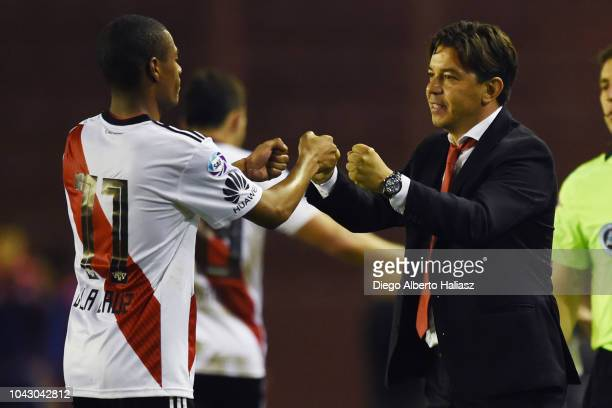 Nicolas De La Cruz celebrates after scoring the fourth goal of his team with Marcelo Gallardo coach of River Plate during a match between Lanus and...