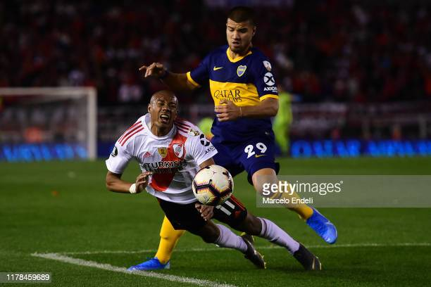Nicolas De La Cruz of River Plate falls as he fights for the ball with against Marcelo Weigandt of Boca Juniors during the semi final first leg match...