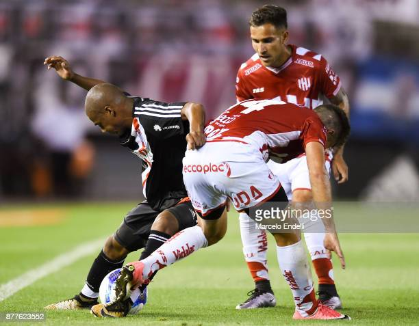 Nicolas De La Cruz of River Plate fights for ball with Bruno Pitton of Union during a match between River and Union as part of Superliga 2017/18 at...