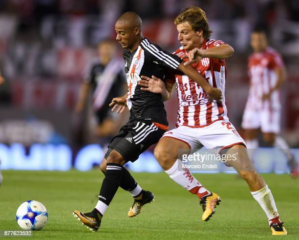 Nicolas De La Cruz of River Plate fights for ball with Manuel De Iriondo of Union during a match between River and Union as part of Superliga 2017/18...