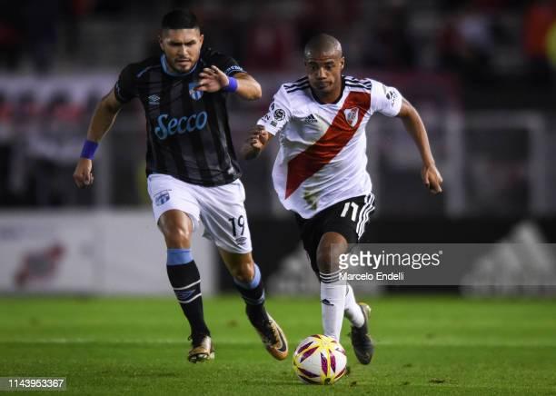 Nicolas De La Cruz of River Plate fights for the ball with David Barbona of Atletico Tucuman during a second leg Quarter Final match of Copa de la...
