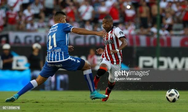 Nicolas De La Cruz of River Plate fights for the ball with Fabrizio Angileri during a match between River Plate and Godoy Cruz as part of Argentina...