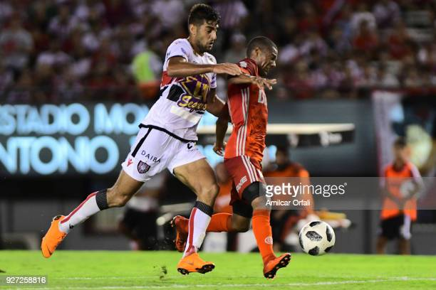 Nicolas De La Cruz of River Plate fights for the ball with Hernan Petryk of Chacarita during a match between River Plate and Chacarita as part of...