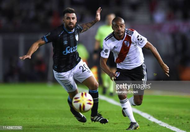 Nicolas De La Cruz of River Plate fights for the ball with Jose San Roman of Atletico Tucuman during a second leg Quarter Final match of Copa de la...
