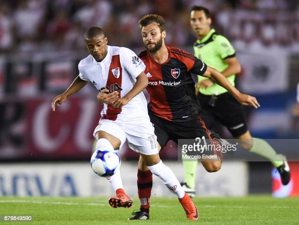 Nicolas De La Cruz of River Plate fights for the ball with Juan Sills of Newell's Old Boys during a match between River and Newell's Old Boys as part...