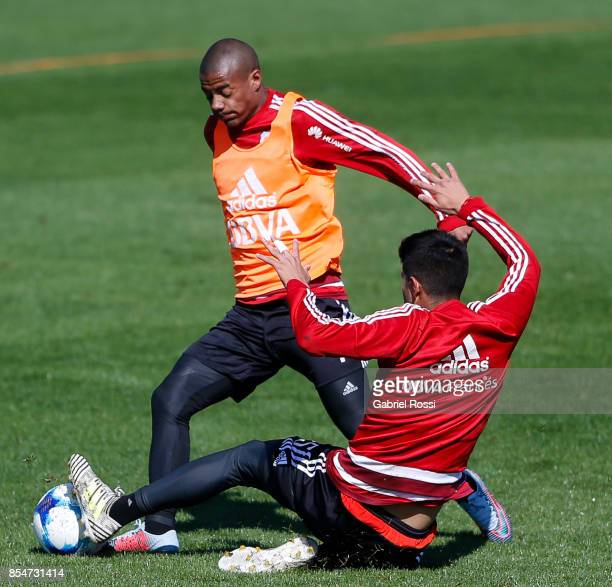 Nicolas De la Cruz of River Plate fights for the ball with teammate Exequiel Palacios during a training session at River Plate's training camp on...