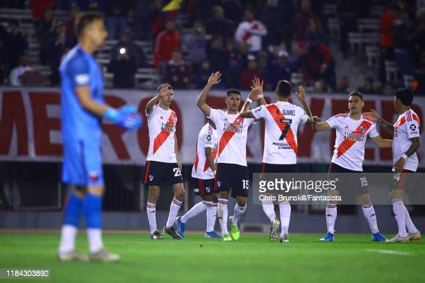 Nicolas De La Cruz of River Plate is congratulated by his team-mates after scoring the opening goal during a match between River Plate and Colón as...