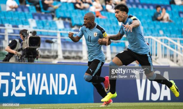 Nicolas de la Cruz of Uruguay celebrates with Joaquin Ardaiz of Uruguay after scoring his teams first goal during the FIFA U20 World Cup Korea...
