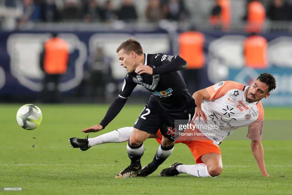 Nicolas De Preville of Bordeaux and Pedro Felipe Teodosio Mendes of Montpellier in action during the Ligue 1 match between FC Girondins de Bordeaux and Montpellier Herault SC at Stade Matmut Atlantique on December 21, 2017 in Bordeaux, .