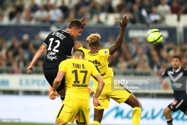 Nicolas De Preville of Bordeaux heads the ball under pressure from Presnel Kimpembe of Paris during the Ligue 1 match between FC Girondins de...