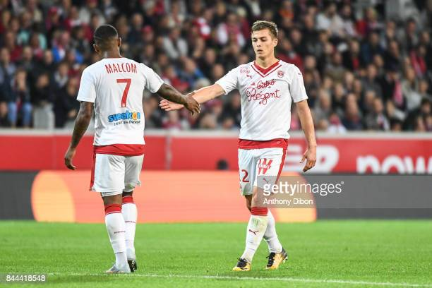 Nicolas De Preville of Bordeaux shakes hand with Malcom during the Ligue 1 match between Lille OSC and FC Girondins de Bordeaux at Stade Pierre...