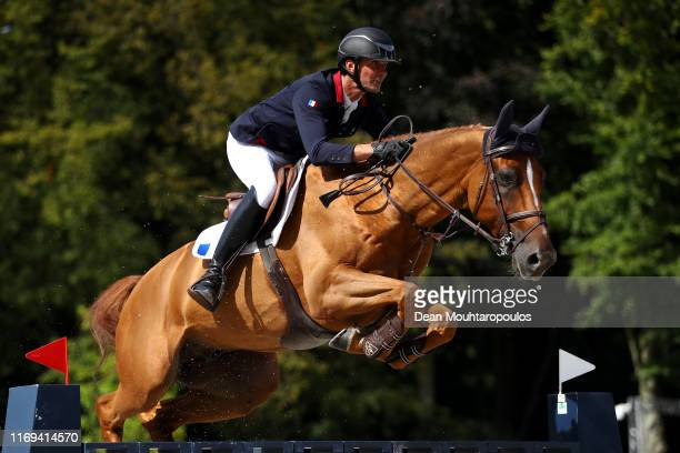 Nicolas Delmotte of France riding Urvoso du Roch competes during Day 3 of the Longines FEI Jumping European Championship speed competition against...