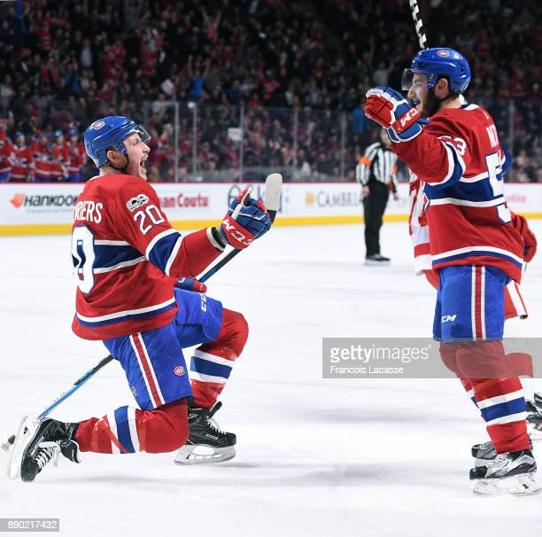 Nicolas Deslauriers and Victor Mete of the Montreal Canadiens celebrate after scoring a goal against the Detroit Red Wings in the NHL game at the...