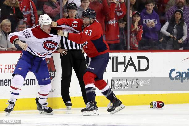 Nicolas Deslauriers of the Montreal Canadiens and Tom Wilson of the Washington Capitals fight i the third period at Capital One Arena on January 19...