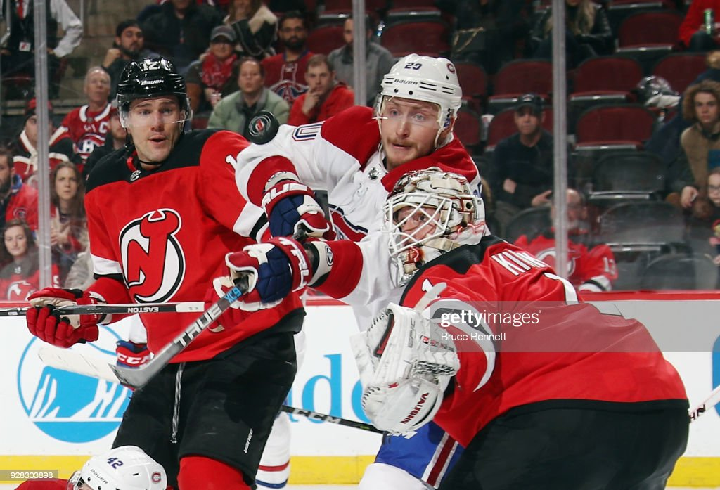 Nicolas Deslauriers #20 of the Montreal Canadiens attempts to deflect a shot past Keith Kinkaid #1 of the New Jersey Devils during the third period at the Prudential Center on March 6, 2018 in Newark, New Jersey. The Devils defeated the Canadiens 6-4.