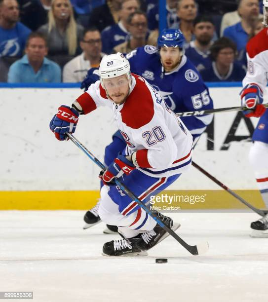 Nicolas Deslauriers of the Montreal Canadiens brings the puck up the ice against the Tampa Bay Lightning during the first period at Amalie Arena on...