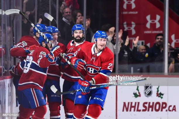 Nicolas Deslauriers of the Montreal Canadiens celebrates a goal in the first period with teammates against the Detroit Red Wings during the NHL game...