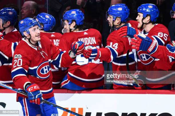 Nicolas Deslauriers of the Montreal Canadiens celebrates his first period goal with teammates on the bench against the Detroit Red Wings during the...