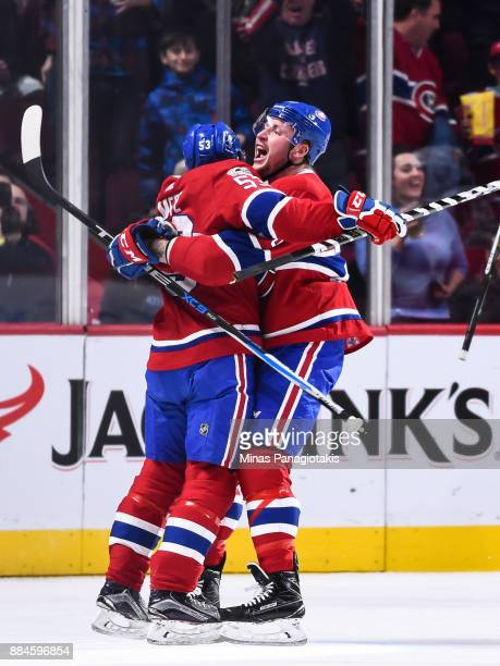 Nicolas Deslauriers of the Montreal Canadiens celebrates his first period goal with teammate Victor Mete against the Detroit Red Wings during the NHL...