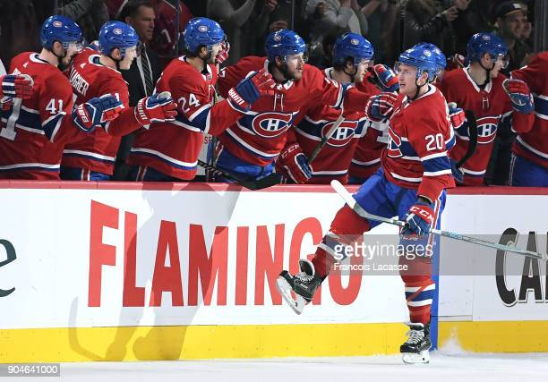 Nicolas Deslauriers of the Montreal Canadiens celebrates with the bench after scoring a goal against the Boston Bruins in the NHL game at the Bell...
