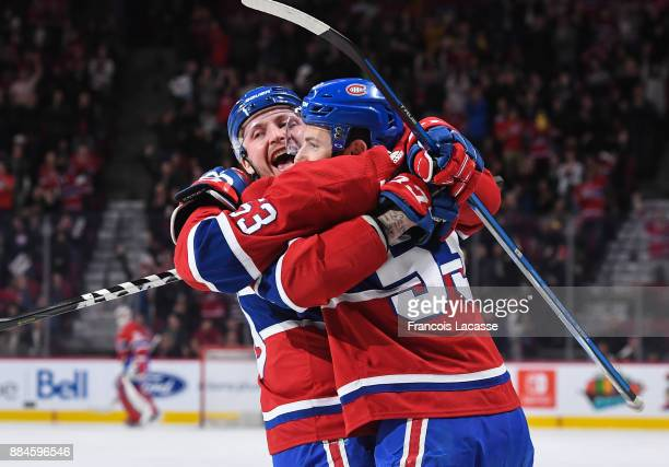 Nicolas Deslauriers of the Montreal Canadiens celebrates with Victor Mete after scoring a goal against the Detroit Red Wings in the NHL game at the...
