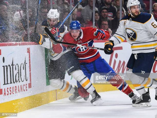 Nicolas Deslauriers of the Montreal Canadiens checks Rasmus Ristolainen of the Buffalo Sabres into the boards in the NHL game at the Bell Centre on...
