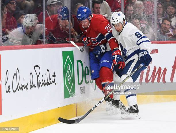 Nicolas Deslauriers of the Montreal Canadiens fights for the puck against Connor Carrick of the Toronto Maple Leafs in the NHL game at the Bell...