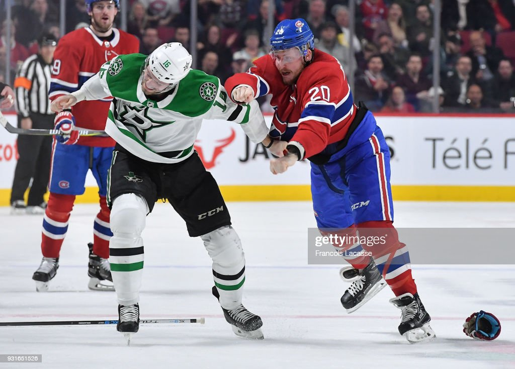Nicolas Deslauriers #20 of the Montreal Canadiens fights Jason Dickinson #16 of the Dallas Stars in the NHL game at the Bell Centre on March 13, 2018 in Montreal, Quebec, Canada.
