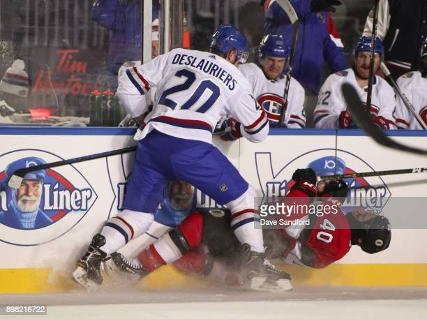 Nicolas Deslauriers of the Montreal Canadiens hits Gabriel Dumont of the Ottawa Senators into the boards during the 2017 Scotiabank NHL100 Classic at...