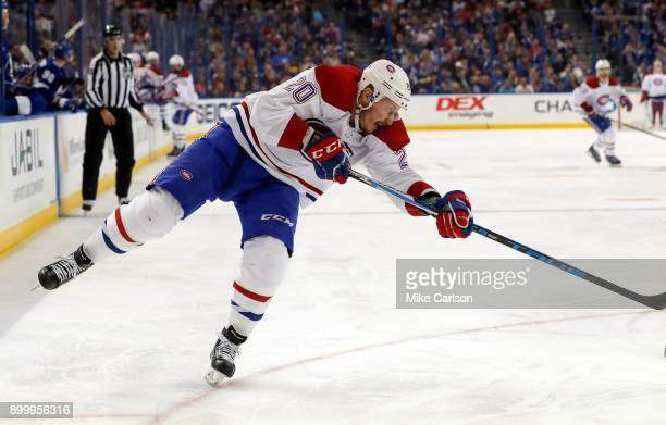 Nicolas Deslauriers of the Montreal Canadiens shoots against the Tampa Bay Lightning during the first period at Amalie Arena on December 28 2017 in...