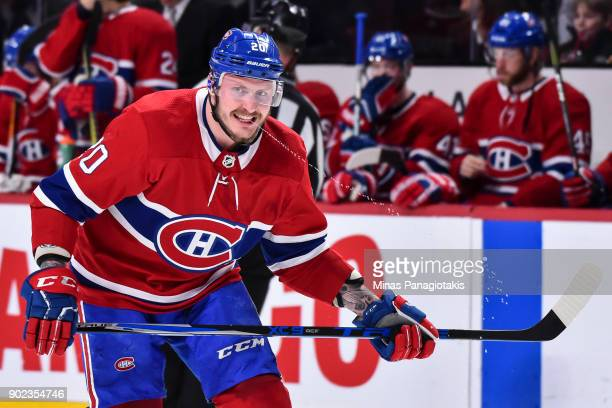 Nicolas Deslauriers of the Montreal Canadiens squirts water from his mouth against the Vancouver Canucks during the NHL game at the Bell Centre on...