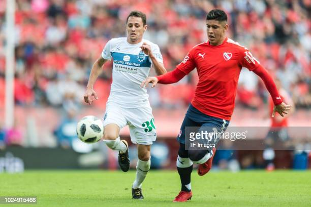 Nicolas Dibble of Gimnasia and Alan Franco of Independiente battle for the ball during the Primera Division match between Independiente and Gimnasia...