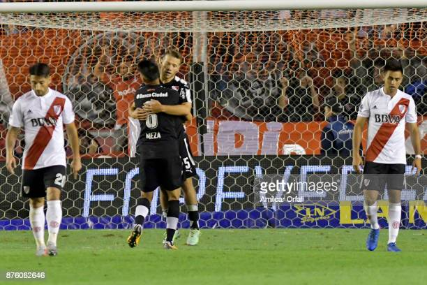 Nicolas Domingo of Independiente celebrates with teammate Maximiliano Meza after scoring the first goal of his team during a match between...