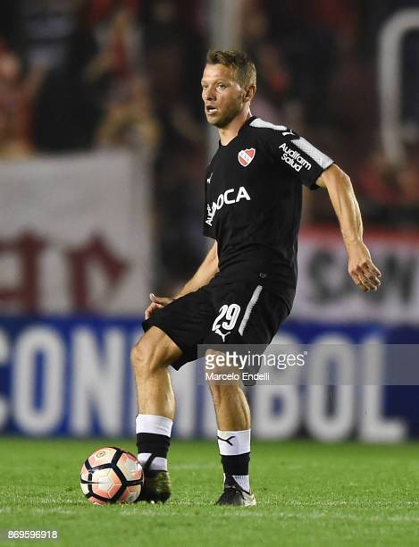 Nicolas Domingo of Independiente kicks the ball during a second leg match between Independiente and Nacional as part of the quarter finals of Copa...