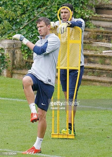Nicolas Douchez and Salvatore Sirigu of Paris SaintGermain during a training session at Clairefontaine training center on August 07 2013 in...