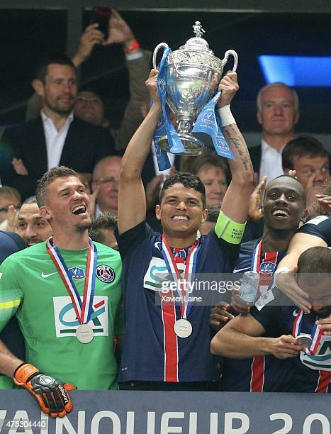 Nicolas Douchez Captain Thiago Silva and Blaise Matuidi of Paris SaintGermain raised the cup after the French Cup Final between AJ Auxerre and Paris...