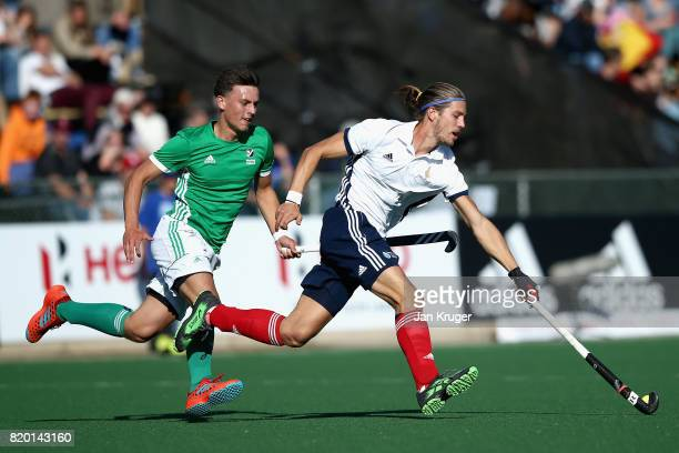 Nicolas Dumont of France takes the ball away from Matthew Nelson of Ireland during the 5th8th place play off match between Ireland and France on Day...