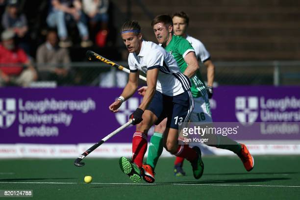 Nicolas Dumont of France takes the ball away from Shane O'Donoghue of Ireland during the 5th8th place play off match between Ireland and France on...
