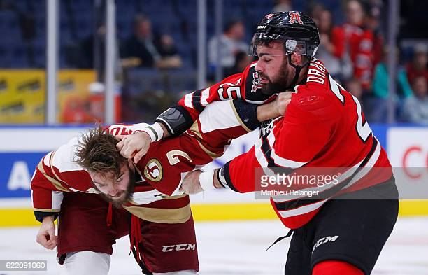 Nicolas Dumulong of the Acadie-Bathurst Titan and Alexandre Drapeau of the Quebec Remparts fight during their QMJHL hockey game at the Centre...