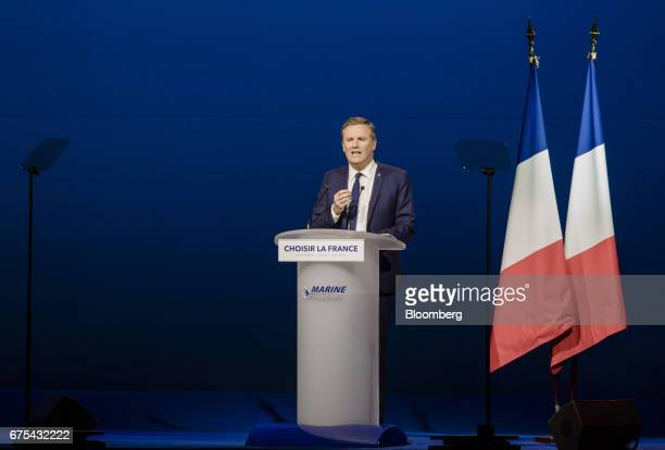 Nicolas DupontAignan a member of the National Assembly of France speaks during a campaign event with Marine Le Pen France's presidential candidate in...