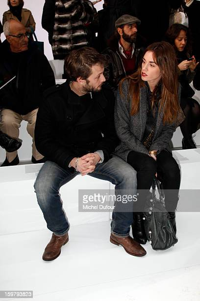 Nicolas Duvauchelle and Laura Isaaz attend the Dior Homme Men Autumn / Winter 2013 show as part of Paris Fashion Week on January 19 2013 in Paris...