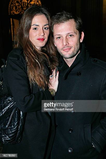 Nicolas Duvauchelle and Laura Isaaz attend the Etam Live Show Lingerie at Bourse du Commerce on February 26 2013 in Paris France