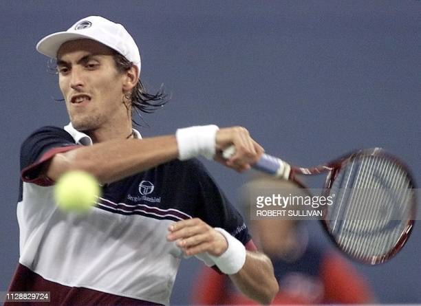 Nicolas Escude of France returns a shot to Andre Agassi of the US in their quarterfinal match 08 September 1999 at the US Open in Flushing Meadows NY...