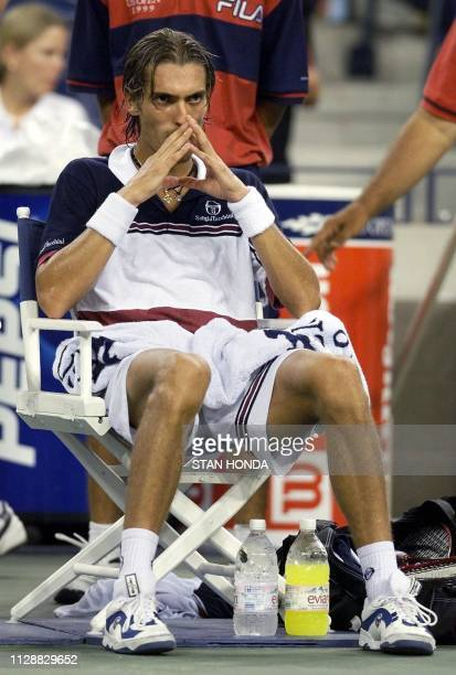 Nicolas Escude of France sits between games during his loosing quarterfinal match against Andre Agassi of the US 08 September 1999 at the US Open in...
