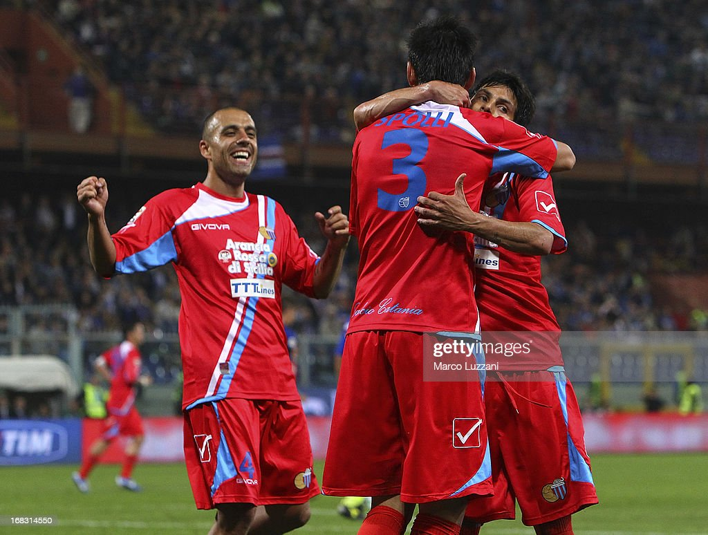 Nicolas Federico Spolli #3 of Calcio Catania celebrates with his team-mates Pablo Cesar Barrientos (R) and Sergio Bernardo Almiron (L) after scoring during the Serie A match between UC Sampdoria and Calcio Catania at Stadio Luigi Ferraris on May 8, 2013 in Genoa, Italy.